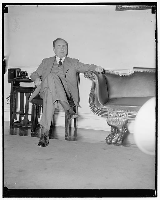 German Ambassador cools his heels. Washington, D.C., Nov. 22. German Ambassador Hans Dieckhoff cools his heels as he waits alone in the diplomatic room before being ushered into the office of Secretary of State Cordell Hull on whom he paid a farewell call today before leaving for the homeland.  November 22, 1938.  (Library of Congress)