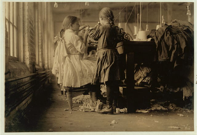 Two of the tiny workers, a raveler and a looper in Loudon Hosiery Mills. Location: Loudon, Tennessee. (December 1910)