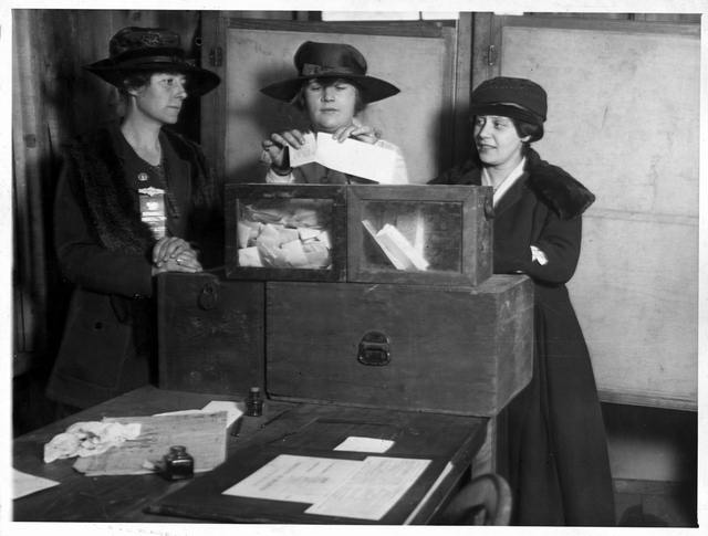 Three suffragists casting votes, circa 1917, possibly New York City.