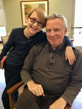 Katie continues to be a caregiver to her dad (shown here with Katie's son, Noah) while he lives in a memory care assisted living program.