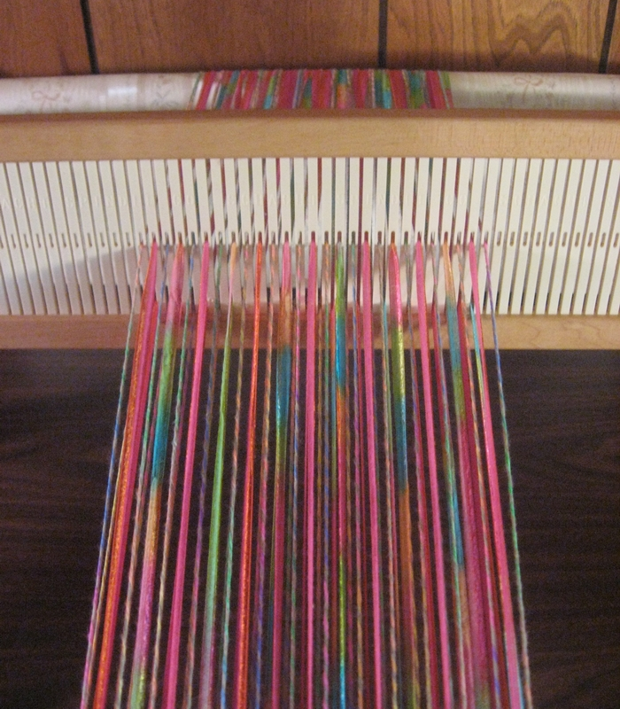 Ribbon and cotton yarn threaded on an 8 dent rigid heddle
