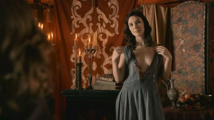 Shae (Sibel Kekilli) undresses for Tyrion Lannister's (Peter Dinklage)