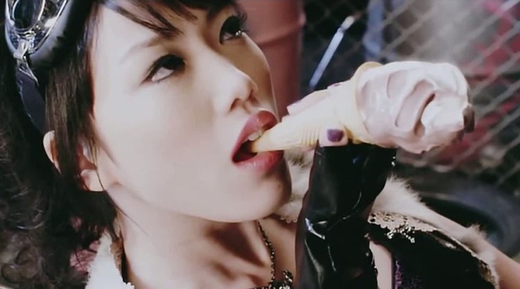 Asian Girl consumes Ice Cream cone very sensually 900x500