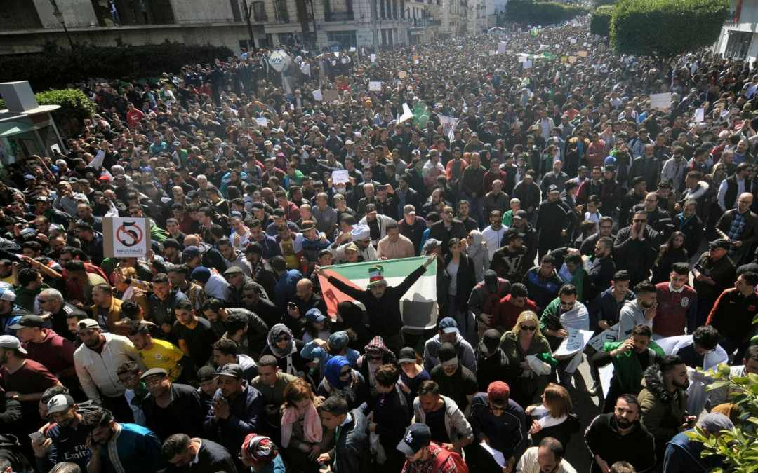 Masses of Algerians surged through the capital