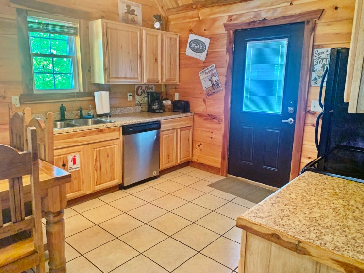 Large kitchen in rustic cabin