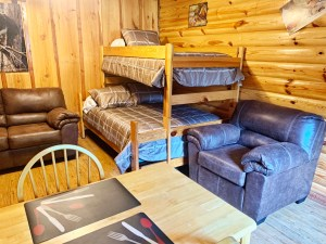 Living area with bunk beds in rustic cabin