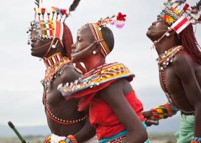 Marcy Mendelson, The Samburu Story | A dance called the 'maasani', the moran and women hold hands and dance together.  Outside Kisima, Samburu County, Kenya.  August 22, 2013.