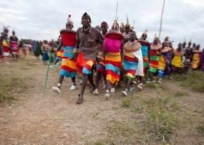 Marcy Mendelson, The Samburu Story | Morans & young women celebrate with dancing and singing into the night.  Pictured here is the partner dance called Maasani.