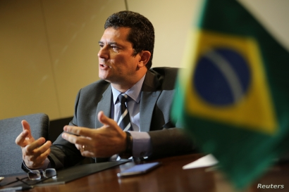 Brazil's Justice Minister Sergio Moro talks during an interview with Reuters in Brasilia, Brazil, Aug. 12, 2019.