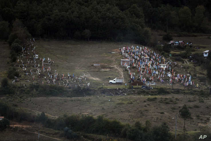 Workers prepare a grave in the cemetery where environmental activist Homero Gomez Gonzalez was to be buried the following day,…