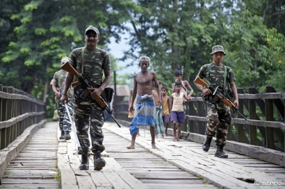 Indian security personnel patrol on a road ahead of the publication of the final draft of the National Register of Citizens (NRC), at Kachari Para village, in Hojai district, northeastern state of Assam, India, Aug. 30, 2019.