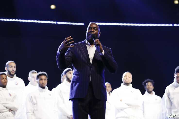 Magic Johnson speaks during a tribute to former NBA All-Star Kobe Bryant and his daughter Gianna who were killed in a…