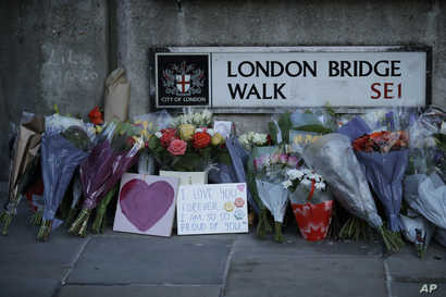 Tributes are seen at the southern end of London Bridge in London, Dec. 2, 2019, after a man previously convicted of terrorism offenses stabbed two people to death and injured three others before being shot dead by police.
