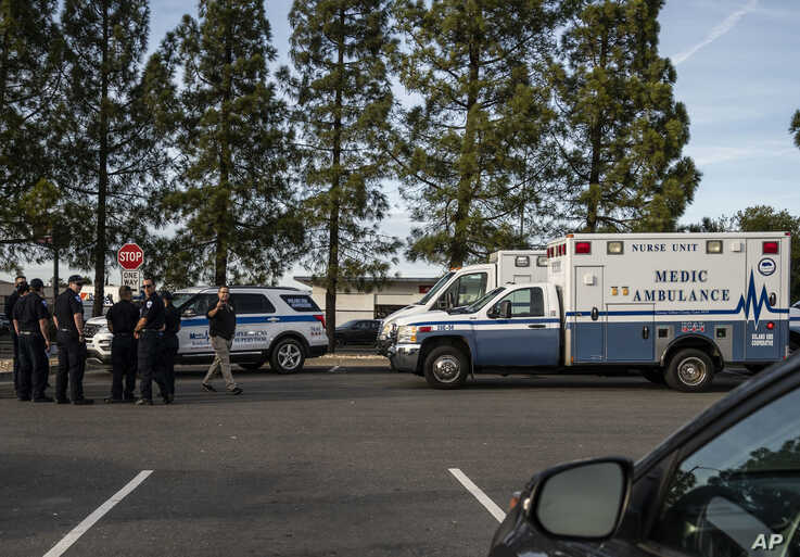 A group of ambulances from the Solano EMS Cooperative stage at the visitor center at Travis Air Force Base, adjacent to Fairfield, California, Feb. 16, 2020.