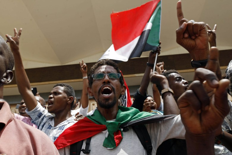Sudanese celebrate following a signing ceremony in the capital Khartoum, Sudan, Aug. 4, 2019.
