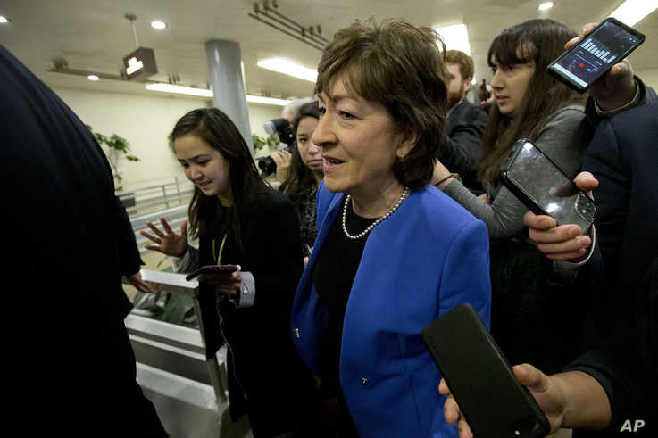 Senators Susan Collins R-ME talks to reporters before attending the impeachment trial of President Donald Trump on charges of…