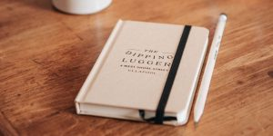 Dipping Lugger notebook and pencil on a desk
