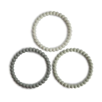 Mushie - Siliconen Bijtring/armband - Pearl Green tea/Cool grey/Sea salt