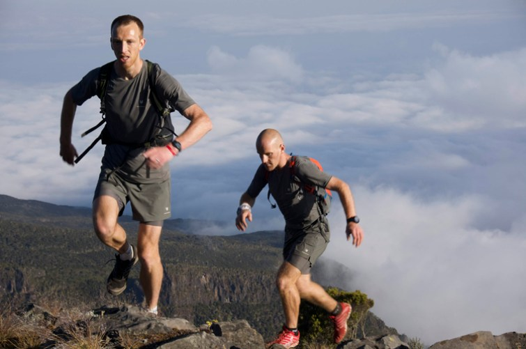 Two Scotsmen have written themselves into the record books by scaling their country's 10 highest peaks in a day