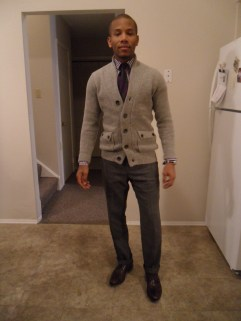 Paired with a purple gingham shirt, donegal tweed pants, silk grey and purple tie and brown wingtips