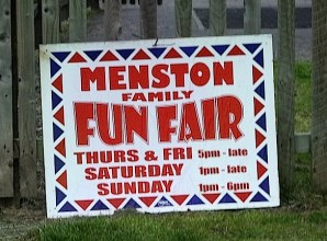 Menston village funfair, notice in recreation ground with opening times, August 8 to 11 2013