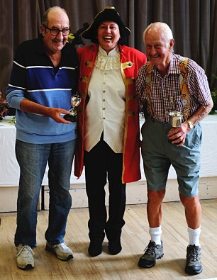 Joint winners of the Fred Ashton Trophy for flowers, Raymond Pollard (left) and Dougie Ascough (right) with Town Crier Eliza Mowe