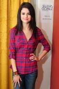 Selena Gomez Backstage in red lining Shirt