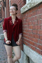 Red Velvet Blazer women stand with wall