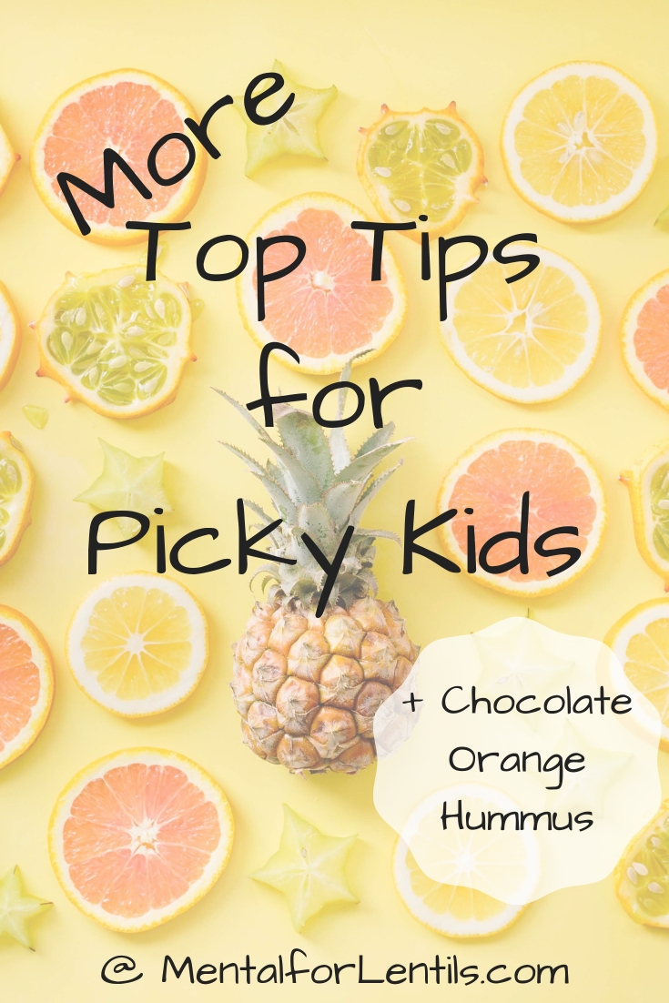 Flat lay of fruit on yellow backdrop with text overlay - More top tips for picky kids