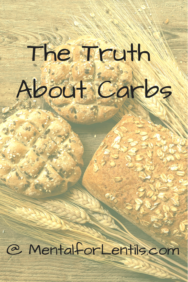 Grain products on wood surface with overlay text - The Truth About Carbs