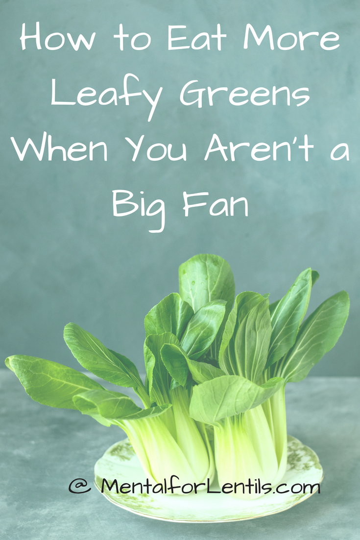 Pak choy on plate with text overlay - How to eat more leafy greens when you aren't a big fan.