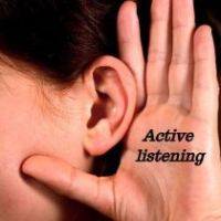 Side of face showing an ear with hand cupped towards it, actively listening
