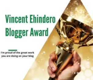 Picture of a hand holding up a gold trophy for the Vincent Ehindero Blogger Award - I'm proud of the great work you are doing on your blog.