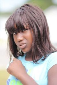 Coloured image of young black teenager appearing troubled