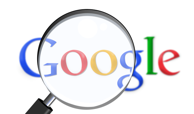 the word Google under a magnifying glass