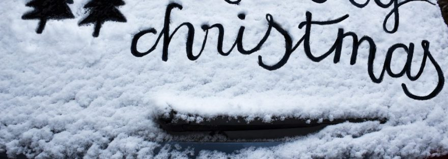 Merry Christmas traced out on a snowy car window