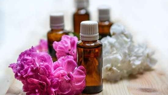 flower blossoms and essential oil vials