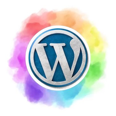 Wordpress logo surrounded by rainbow cloud
