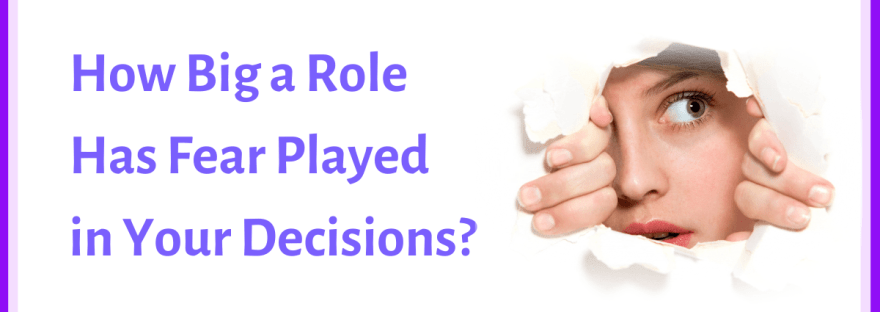 Fear: how big a role has it played in your decision-making? - woman peering through hole torn in paper