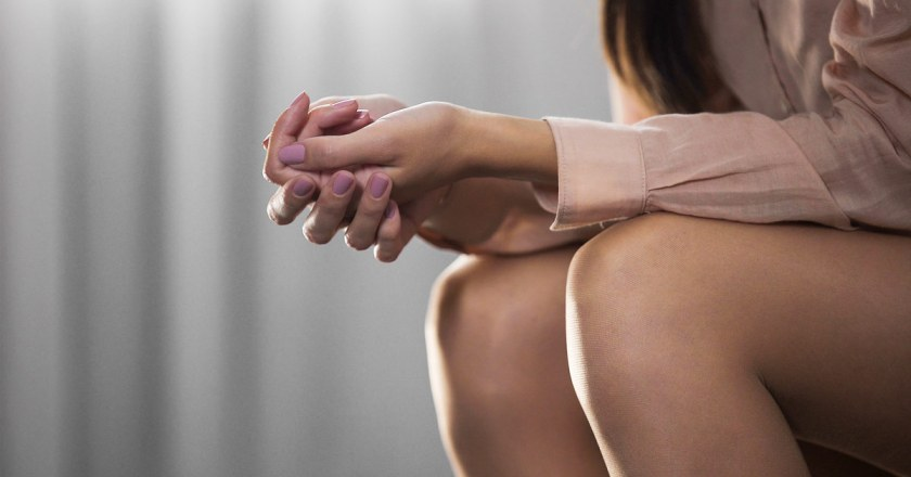 womans hands clasped