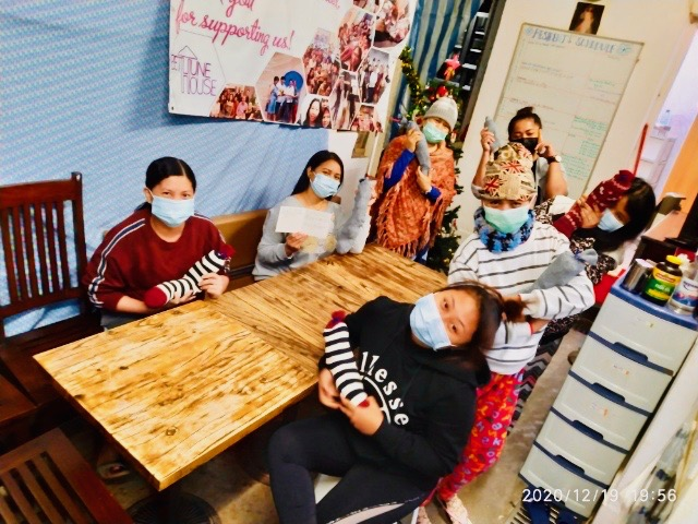 Migrants at Christian Action's Refuge for Domestic Helpers with our Christmas Gift Socks