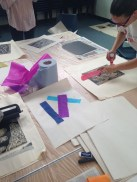 Adding collage to prints, printmaking workshop at Studio 3 Arts residency. © 2015