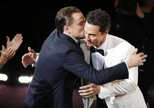 """McConaughey, best actor winner for his role in """"Dallas Buyers Club"""", is congratulated by best actor nominee DiCaprio at the 86th Academy Awards in Hollywood"""
