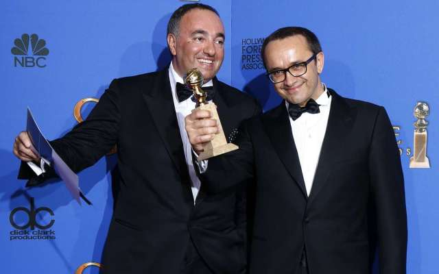"Producer Rodnyansky and director Zvyagintsev pose backstage with their award for Best Foreign Language Film for their film ""Leviathan"" at the 72nd Golden Globe Awards in Beverly Hills"