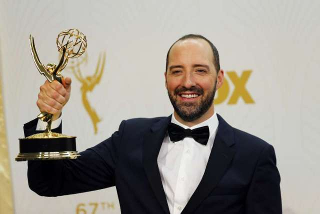 """Actor Tony Hale holds the award for Outstanding Supporting Actor In A Comedy Series for the HBO series """"Veep"""" backstage during the 67th Primetime Emmy Awards in Los Angeles, California September 20, 2015. REUTERS/Mike Blake - RTS22RM"""