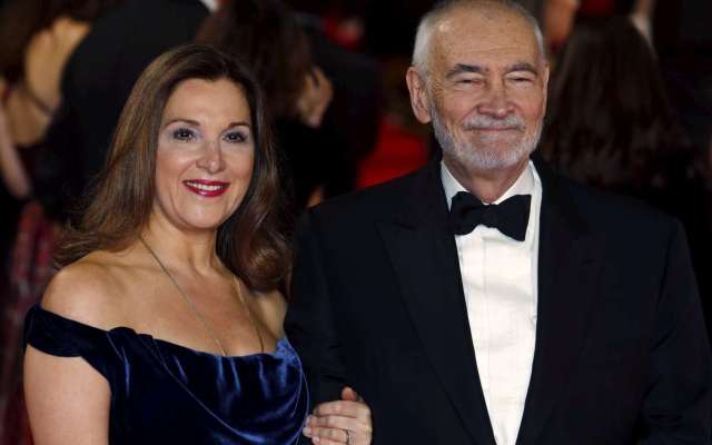 """Producers Barbara Broccoli (L) and Michael G. Wilson pose for photographers on the red carpet at the world premiere of the new James Bond 007 film """"Spectre"""" at the Royal Albert Hall in London, Britain, October 26, 2015. REUTERS/Luke MacGregor - RTX1TCUT"""