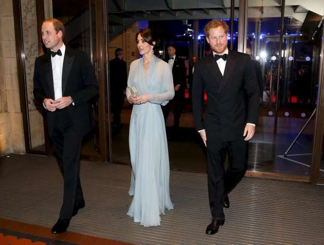 """Prince William, Duke of Cambridge (L), Catherine, Duchess of Cambridge (C) and Prince Harry (R) attend The Cinema and Television Benevolent Fund's Royal Film Performance 2015 of the new James Bond 007 film """"Spectre"""" at Royal Albert Hall on October 26, 2015 in London, England. REUTERS/Chris Jackson/Pool - RTX1TCOT"""