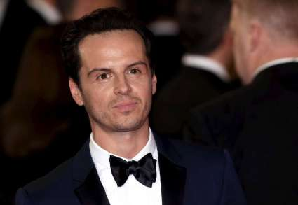 """Andrew Scott poses for photographers on the red carpet at the world premiere of the new James Bond 007 film """"Spectre"""" at the Royal Albert Hall in London"""