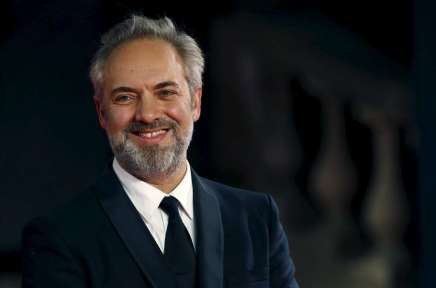 """Film director Sam Mendes poses for photographers on the red carpet at the world premiere of the new James Bond 007 film """"Spectre"""" at the Royal Albert Hall in London"""