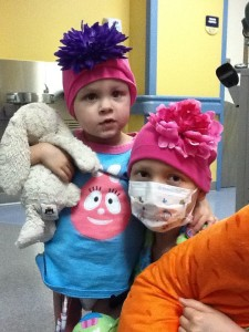Mercede and her friend Claire. Claire is wearing one of the hats Cede gave her.